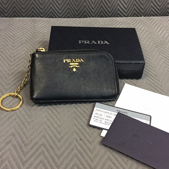 f3aedaea905e63 Prada Saffiano Leather Zip-Around Keychain. M_5ac61a55f9e5013a5063ea95